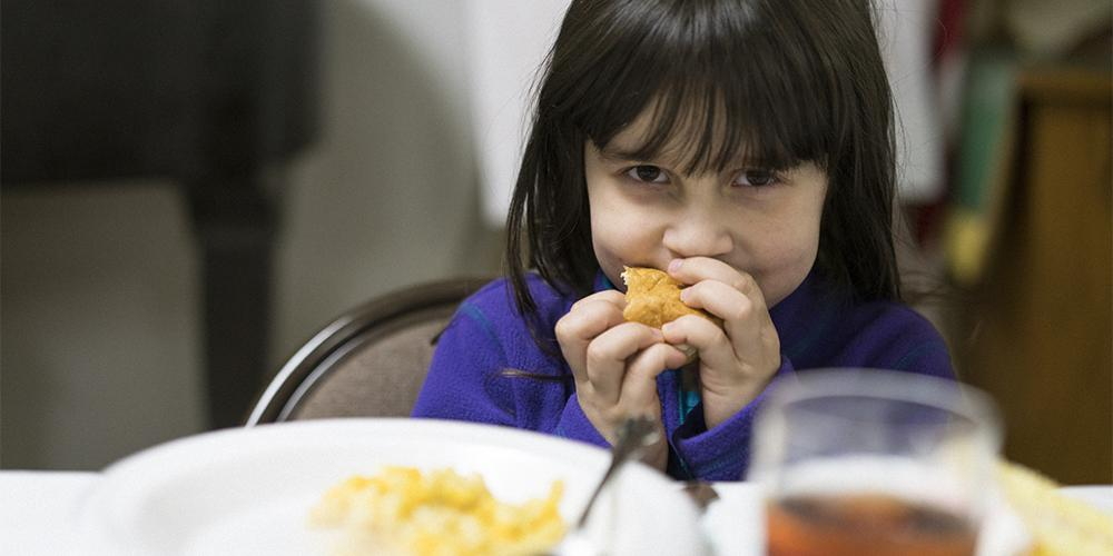 Five-year-old Mojave enjoys Feeding the Spirit's dinner at Otterbein United Methodist Church.